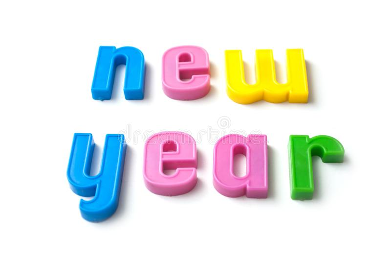 kleurrijke plastic brieven op witte achtergrond - nieuw jaar royalty-vrije stock fotografie