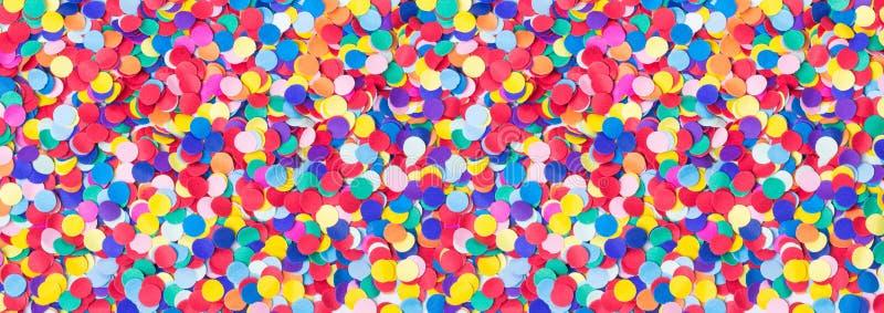 Kleurrijke ronde confettien, achtergrond Carnaval, Oudejaarsavond royalty-vrije stock foto