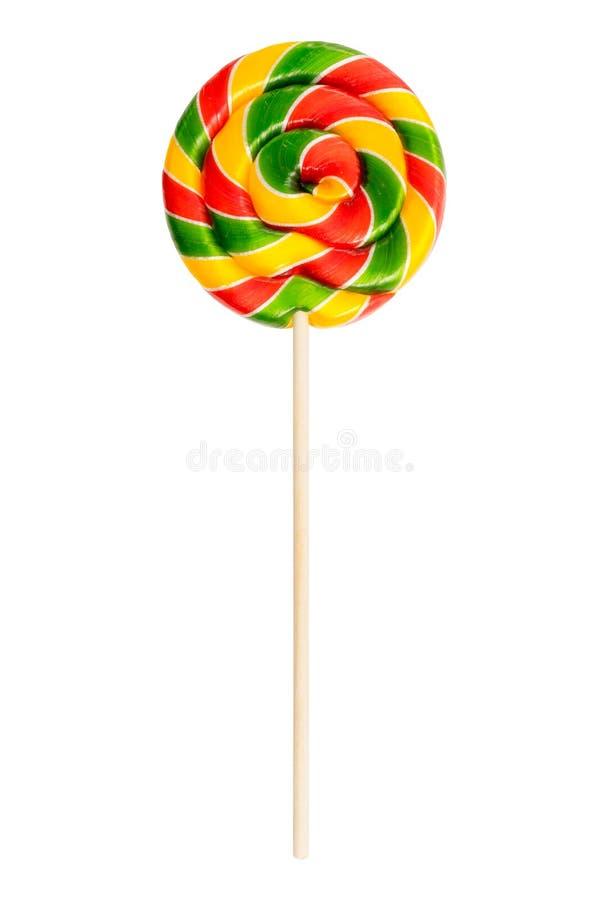 Kleurrijke spiraalvormige die lolly op witte achtergrond wordt geïsoleerda Rood groen geel Suikergoed stock fotografie