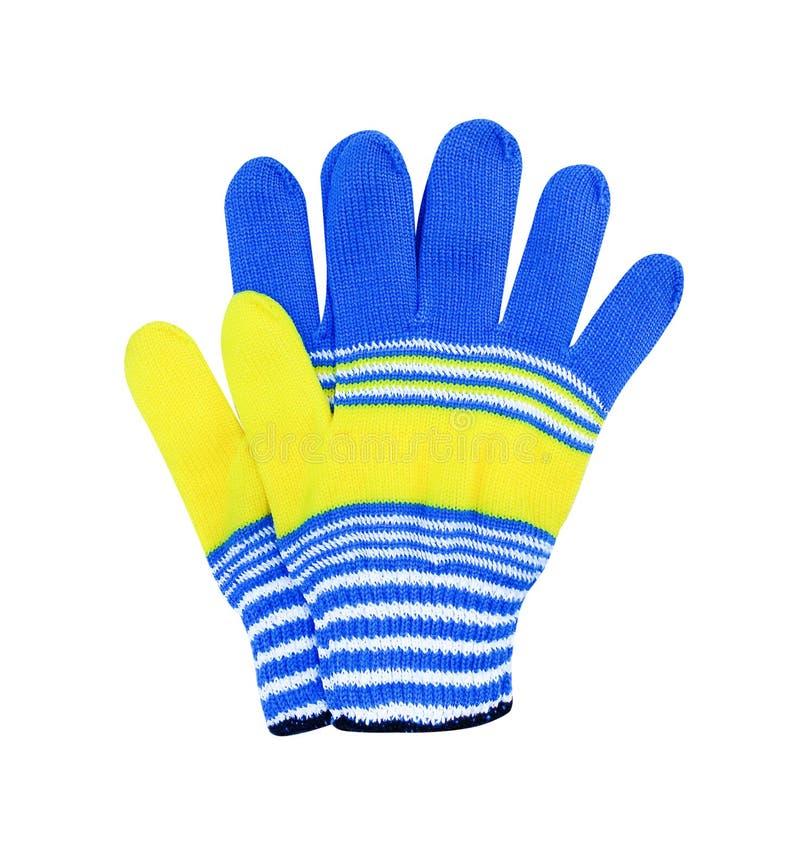 Kleurrijke stoffen blauwe geweven handschoenen met gele en witte gestreept geïsoleerd op witte achtergrond met het knippen van we stock afbeeldingen