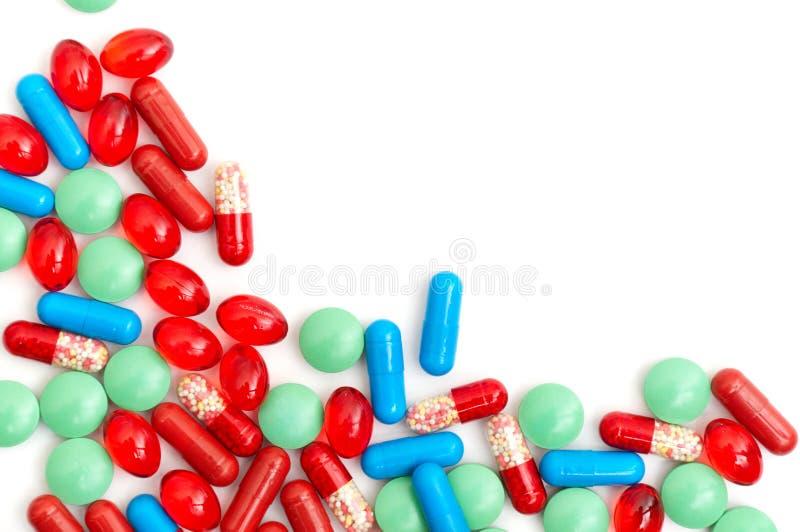 Kleurrijke tabletten met capsules stock foto's