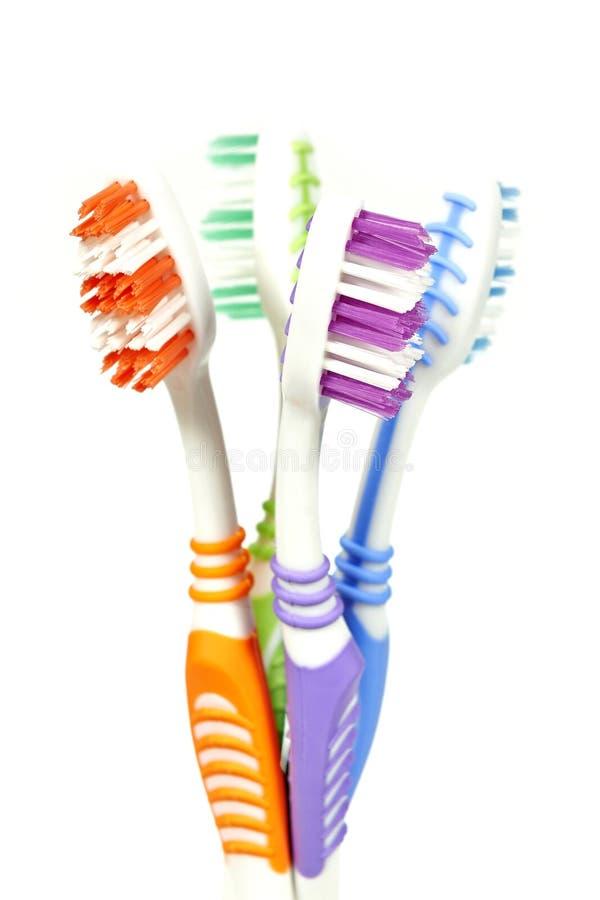 Kleurrijke tandenborstels stock afbeeldingen