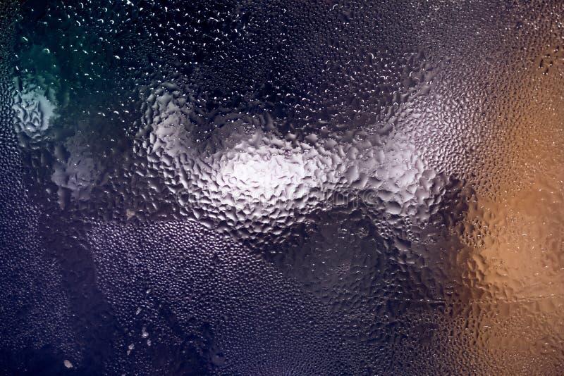 Kleurrijke textuur van water het condenseren op glasoppervlakte royalty-vrije stock fotografie