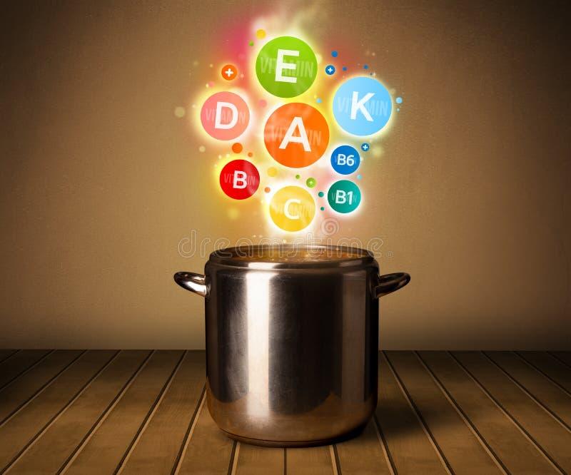Kleurrijke vitaminen die uit uit het koken van pot komen royalty-vrije stock foto