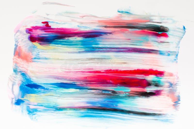 Kleurrijke vlekken van verf op witte vrije ruimte stock afbeeldingen