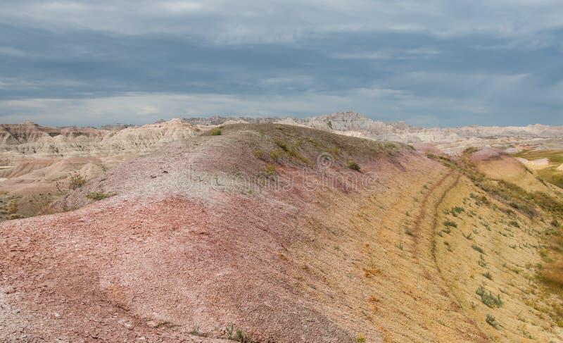 Kleurrijke zandduinen in bewolkte dag stock foto
