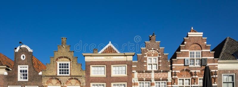 Klev gavelhus i Nieuwstraat Dordrecht Och gjort denna liten stadk?nself?rnimmelse ett stor st?rre royaltyfri foto