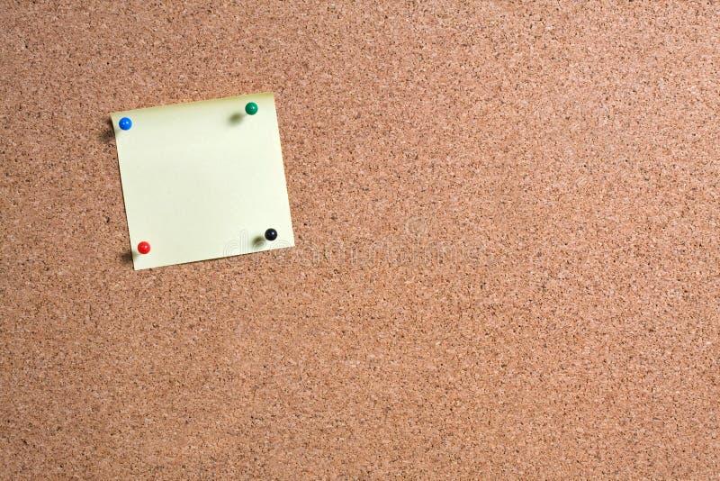 Kleverig Nota's en Cork Board stock afbeelding