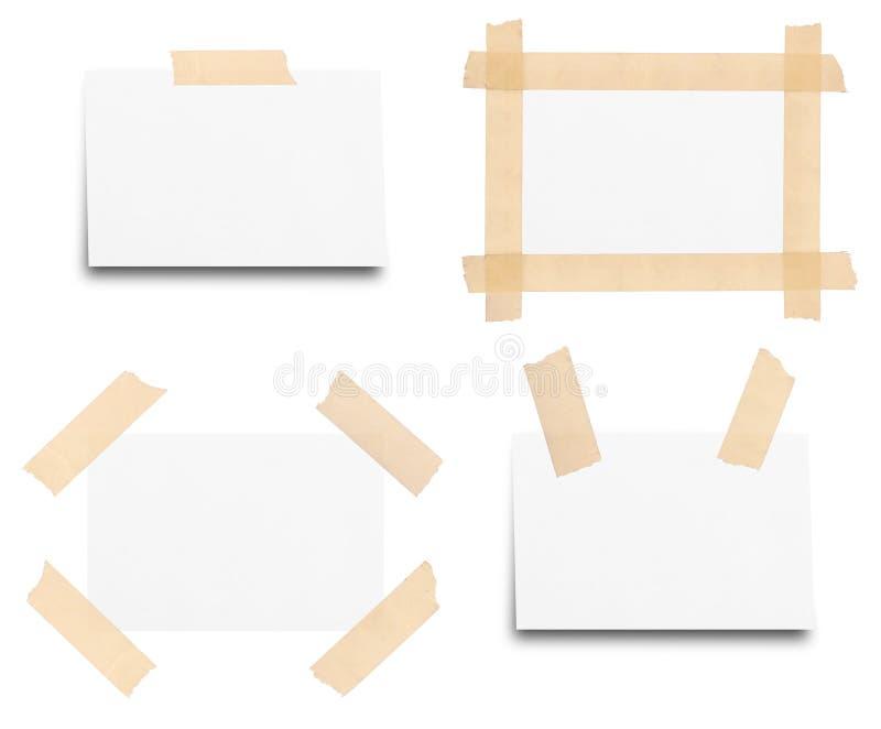 Kleverige band op geïsoleerd notadocument royalty-vrije stock foto's