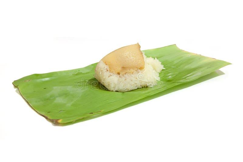 Klibbig rice med ångad custard arkivbilder