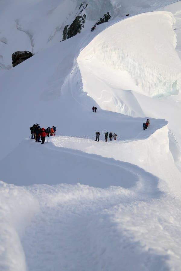 Klimmers in hooggebergte stock foto's