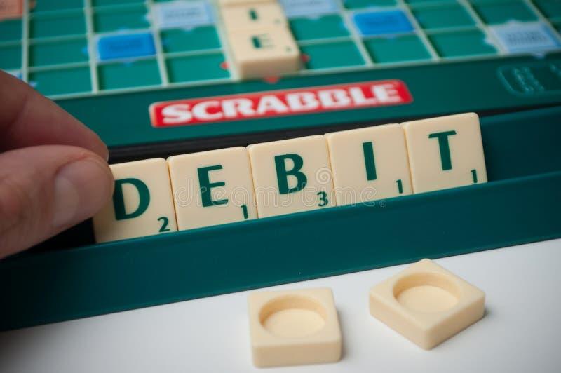 Klingerytów listy na Scrabble grą planszowej z słowem: Debet fotografia royalty free