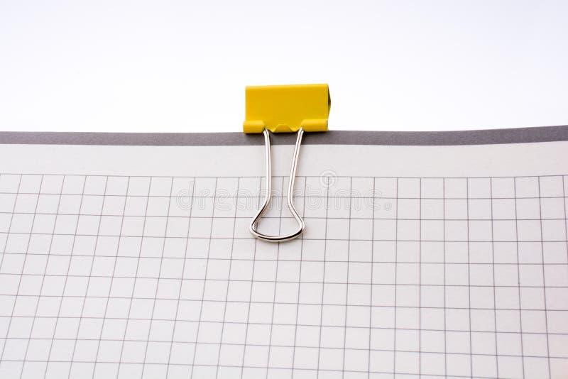 Klipp auf einem Notizbuch stockfoto
