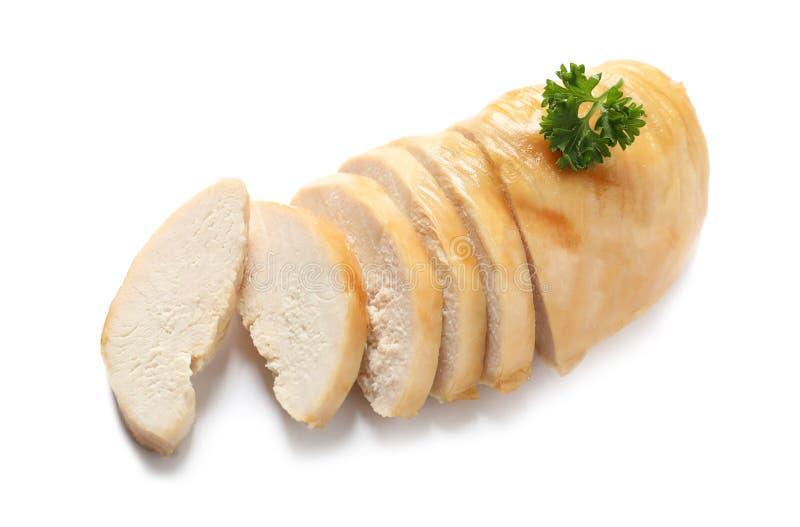 Klipp delvist stekt kycklingbröstet med persilja som isoleras på vit arkivbilder