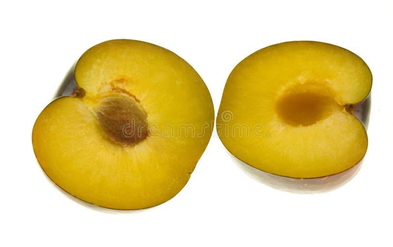klipp den half plommonet royaltyfria foton