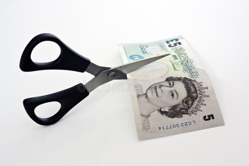 klipper pengar fotografering för bildbyråer