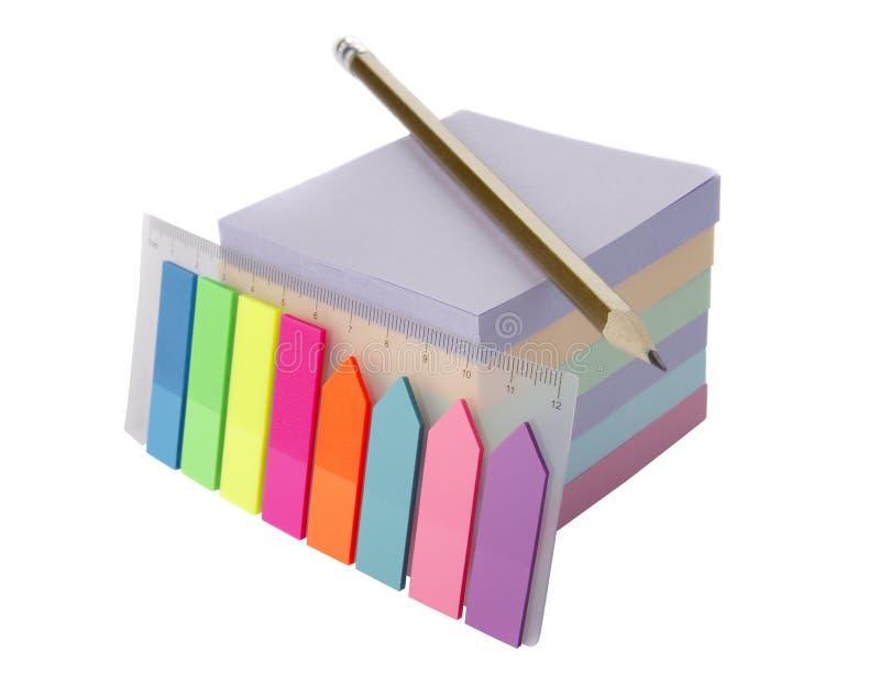 Klistermärkear och blyertspenna royaltyfria bilder