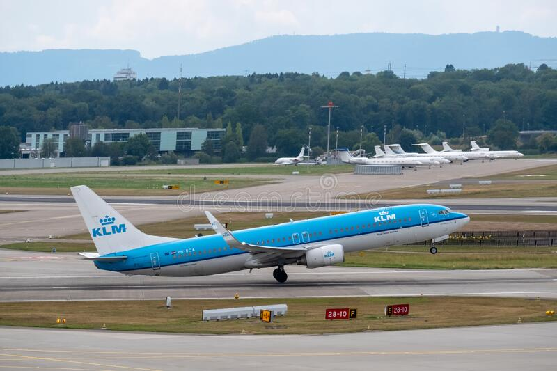 KLM airlines airplanes preparing for take-off at day time in international airport stock photography