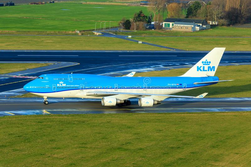 KLM Boeing 747-400. Taxiing at Schiphol Amsterdam Airport. This type will be retired soon by KLM royalty free stock photo