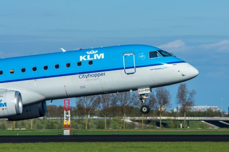 KLM cityhopper aircraft landing at Amsterdam Schiphol Airport royalty free stock photo