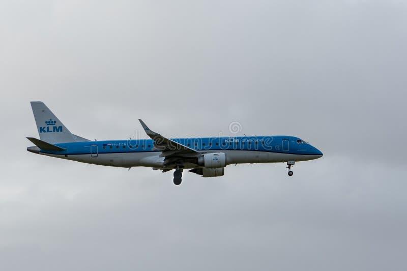 KLM Cityhopper Embraer ERJ-190STD PH-EZN passenger plane taking off from Amsterdam Schiphol Airport stock photo