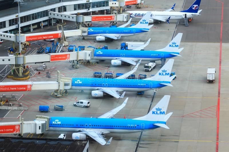 KLM jets at the gate. Four KLM Boeing 737 jets parked next to each other at Schiphol Amsterdam Airport, the Netherlands stock image