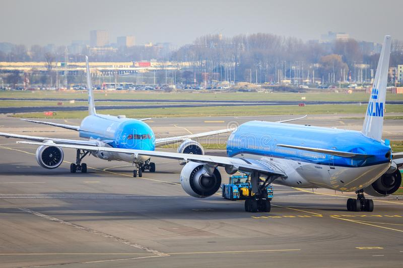 KLM jets nose to nose. Two KLM widebody jets Boeing 777 and Boeing 787 nose to nose on the platform at Amsterdam Airport Schiphol royalty free stock photos