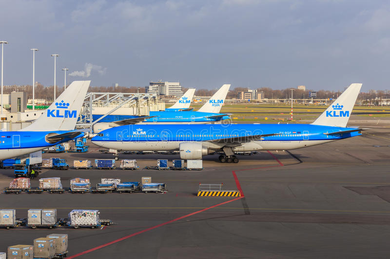 KLM jets at Schiphol. KLM widebody jets at Schiphol Amsterdam Airport, the Netherlands. A Boeing 777 is taxiing to the gate among other KLM jets royalty free stock photos