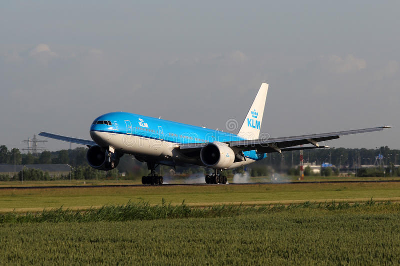 KLM Royal Dutch Airlines Boeing B777. AMSTERDAM - JULY 02: KLM Royal Dutch Airlines Boeing B777 lands at AMS Airport in Netherlands on July 02, 2012. KLM is the royalty free stock image