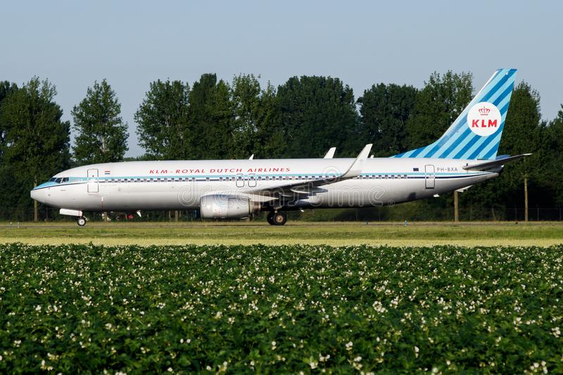 KLM Royal Dutch Airlines special retro livery Boeing 737-800 PH-BXA passenger plane taxiing at Amsterdam Schipol Airport royalty free stock image