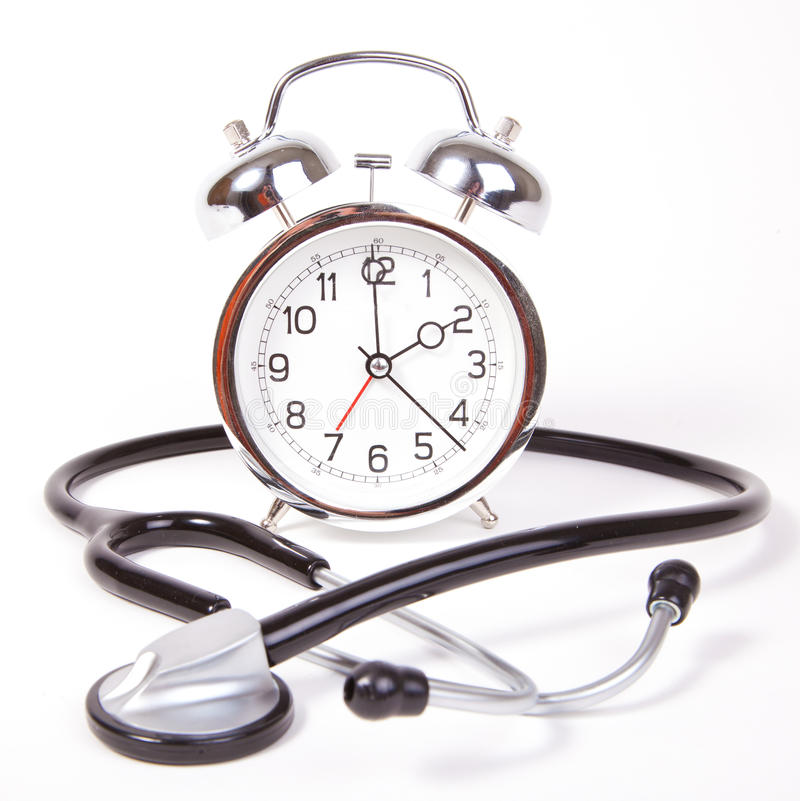 Klocka med stetoskopet royaltyfri bild
