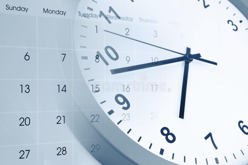 Klocka och kalender arkivfoton