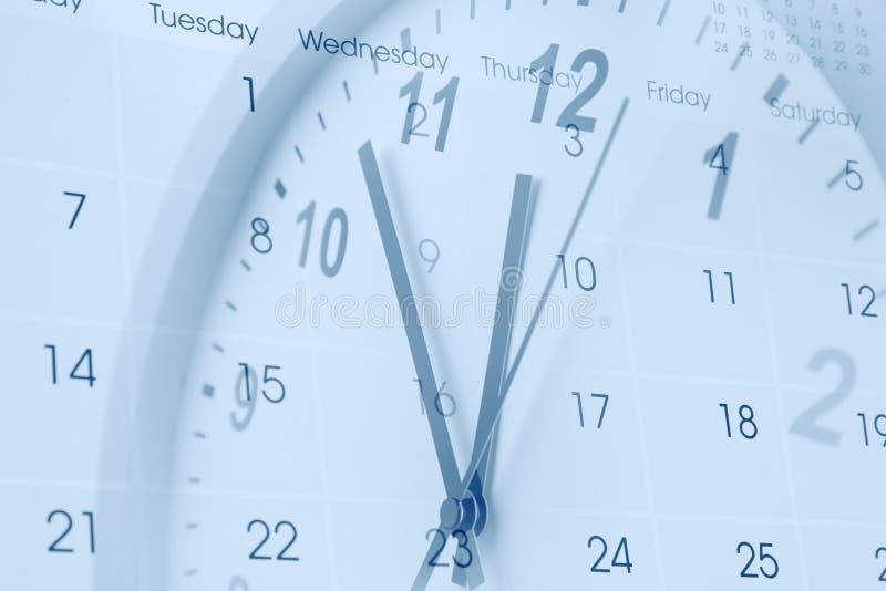 Klocka och kalender fotografering för bildbyråer