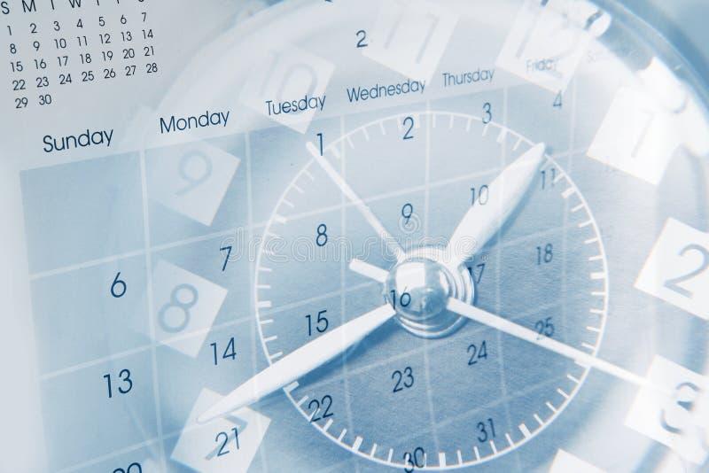 Klocka och kalender arkivbild