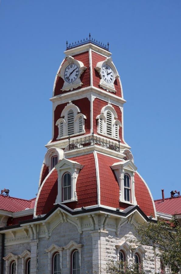 Klocka torn av den ståndsmässiga domstolsbyggnaden royaltyfri fotografi
