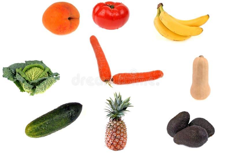 Klockabegrepp med frukter och grönsaker fotografering för bildbyråer