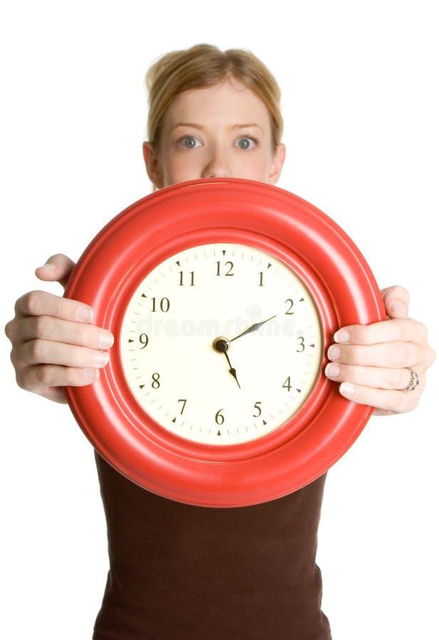 klockaholdingkvinna arkivbilder