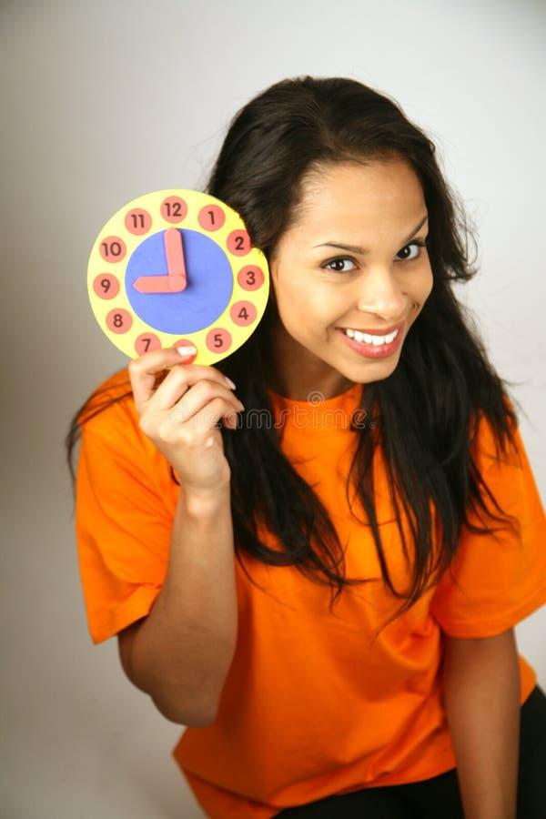 klockakvinna royaltyfri fotografi
