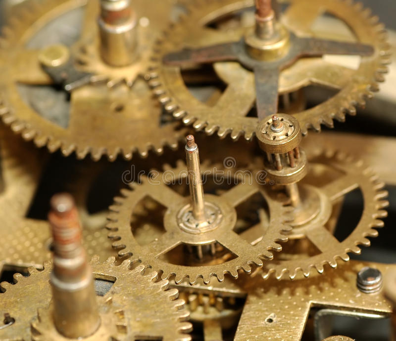 klockan gears mekaniskt arkivbilder