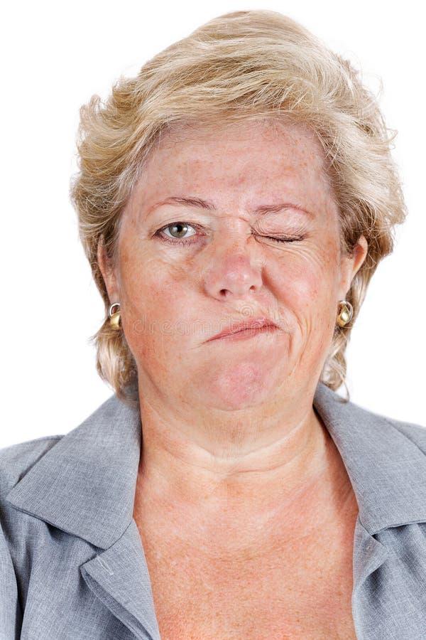 Klockas förlamning - kan inte scrunch upp ögon royaltyfri foto