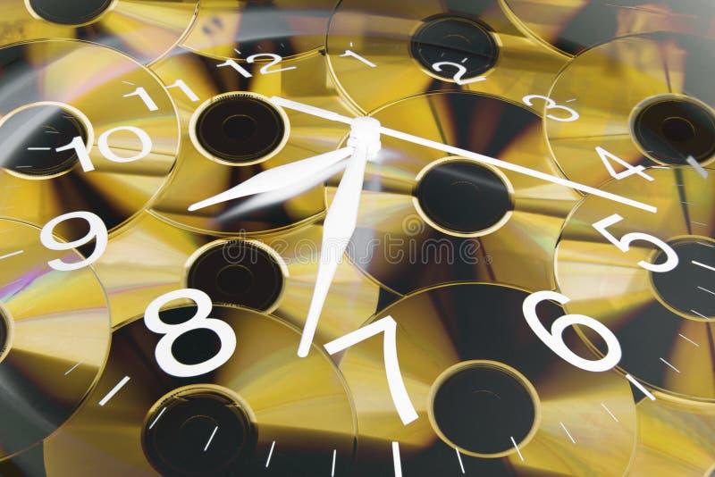 Klok en CDs royalty-vrije stock afbeeldingen