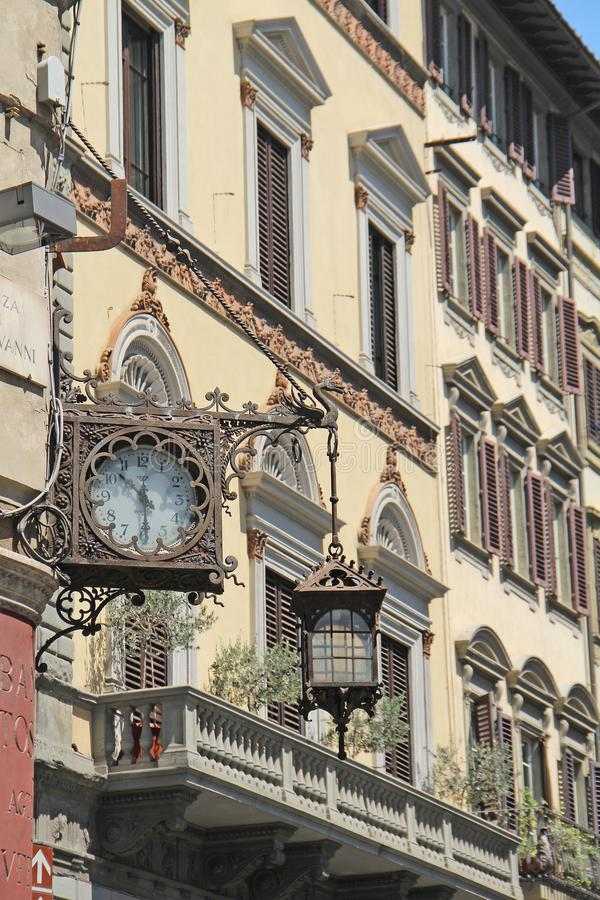 Klok en lantaarn in Florence stock afbeelding