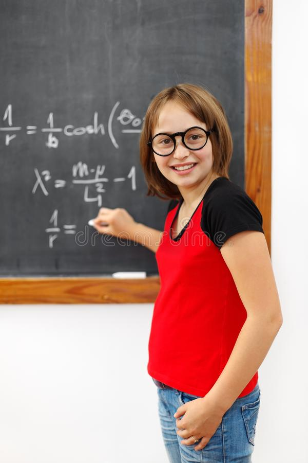 klok mathschoolgirl arkivbild