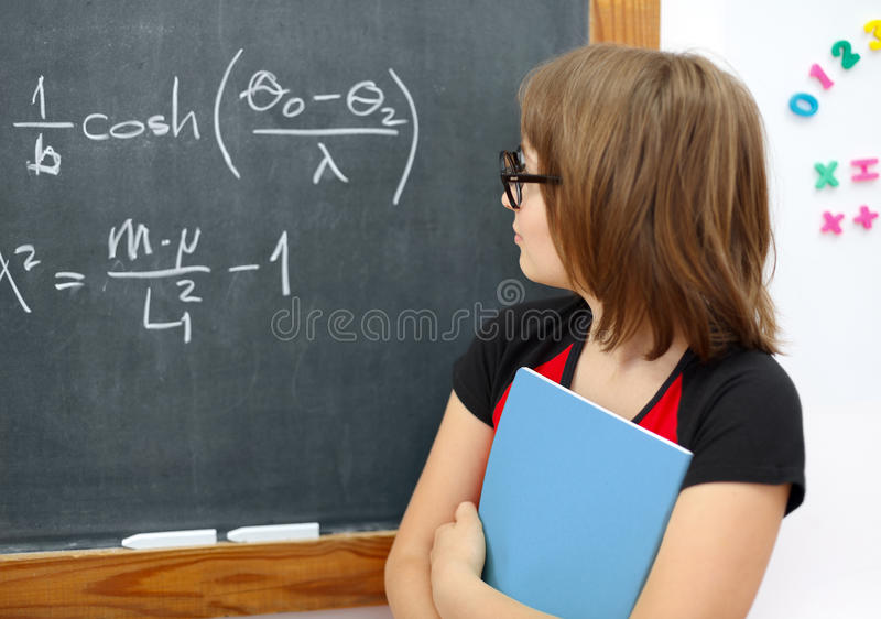 klok mathschoolgirl royaltyfria bilder