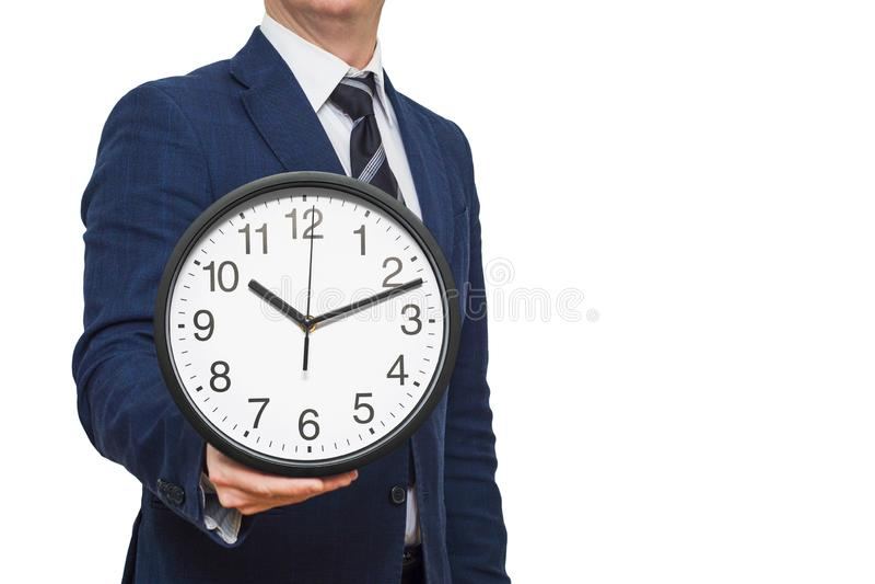 Klok in zakenmanhand Zakenman met een klok in een hand Zakenman met klok op tijd concept royalty-vrije stock afbeelding