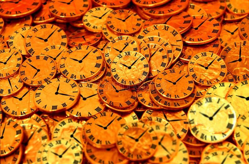 Klokken en muntstukken royalty-vrije stock afbeelding
