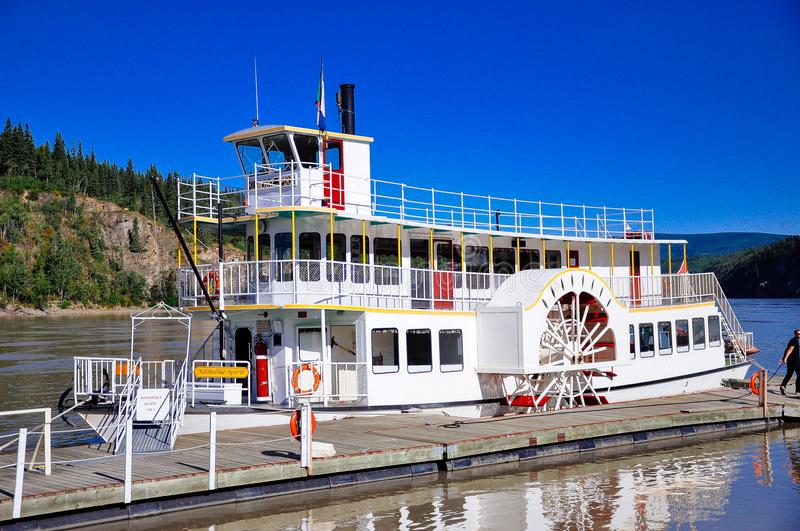 The Klondike Spirit paddlewheel in Dawson City, Yukon. The Klondike Spirit carries up to 50 passengers on board and can accommodate them all in the dining area royalty free stock photography
