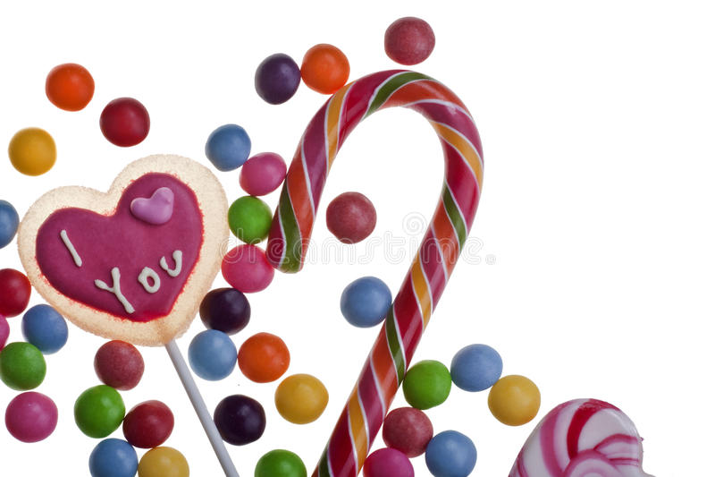 Klubbor och blandade färgrika sötsaker arkivbilder