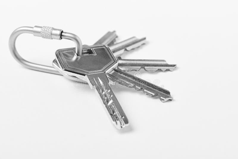 Kluczowy pierścionek z kluczami nad białym tłem proroctwo zdjęcia royalty free