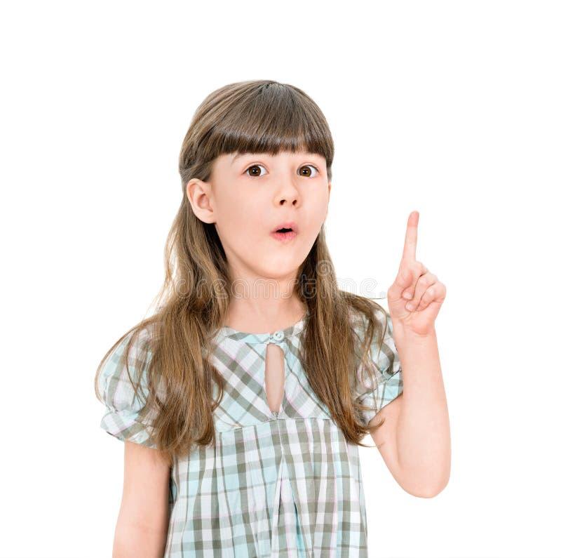Kluges kleines Mädchen mit einer guten Idee stockfotografie
